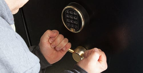 a person opening a safety deposit box
