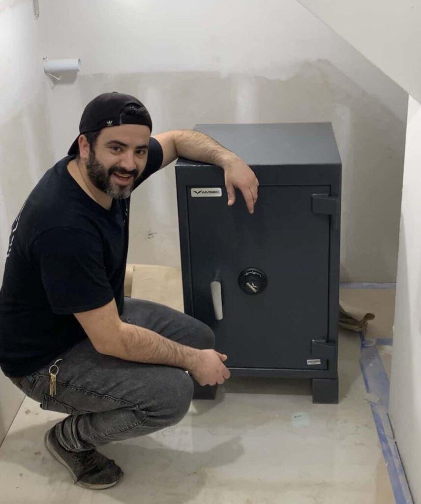 man sitting beside Amsec Vault product